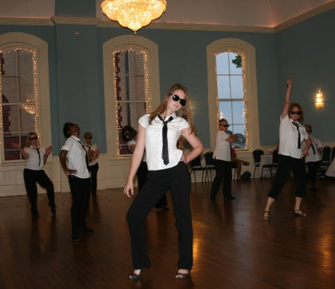 Hip Hop Dance Students dressed in white shirts with black tie and black pants