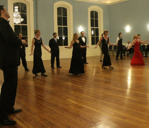 Elegantly dressed ballroom dance students