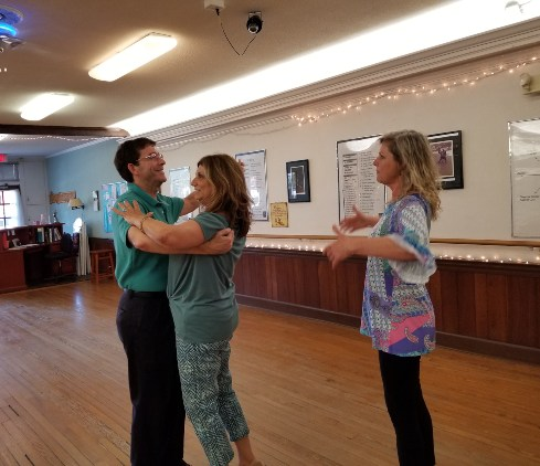 Female dance instructor coaching couple